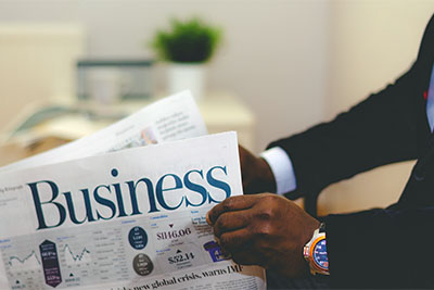 Businessman reading a financial business newspaper