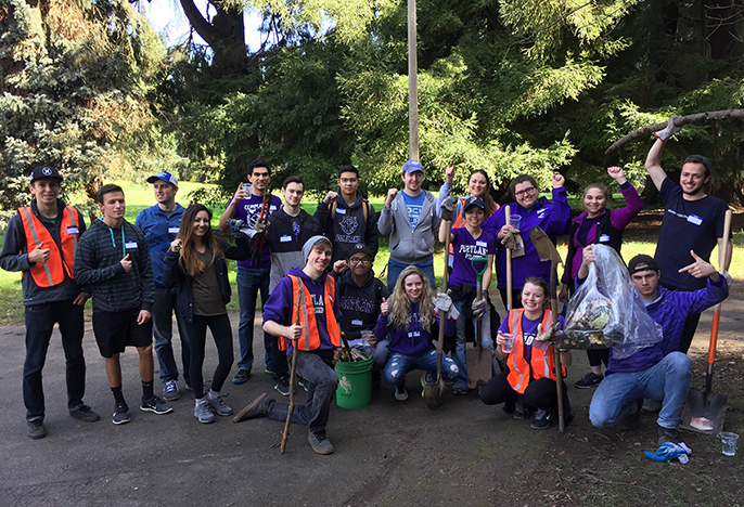 Students engaged in cleaning up a local park as part of service day.